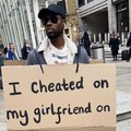 """Community upset over men wearing """"i cheated on my girlfriend signs"""""""