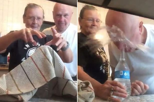 Wife squirts husband with water bottle