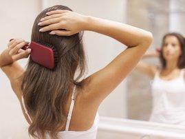 Woman styling hair