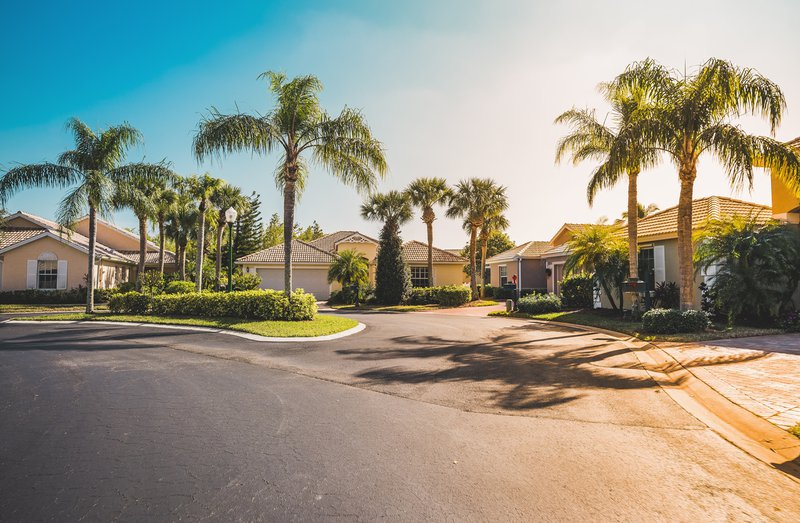 Gated community houses with palms
