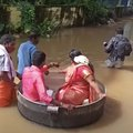 An Indian couple sailed across submerged streets in a massive cooking pot to reach their wedding venue on Monday, as heavy rains flooded the southern state of Kerala.