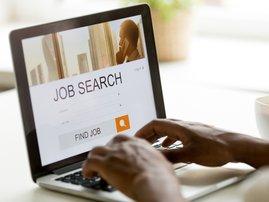 Job seeker typing on laptop