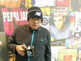 Joey Rasdien image coffee in hand