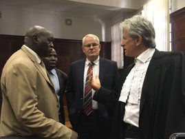 Johan Booysen having a chat with his lawyer