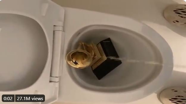 Kanye West peeing on his Grammy Award