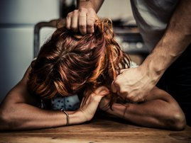 Man hurting woman