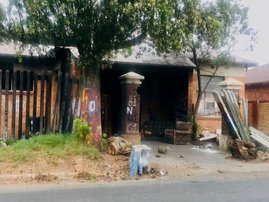 A former mortuary in Springs adjacent to the Geduld cemetery has become home to about 15 people. Photo: Kimberly Mutandiro