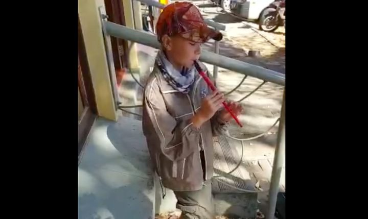 INSPIRING: A young boy uses his flute to bring his family out of hard times