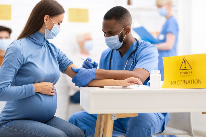 Pregnant woman getting vaccinated