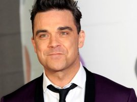 Robbie Williams: From secret back waxing to alien invasions