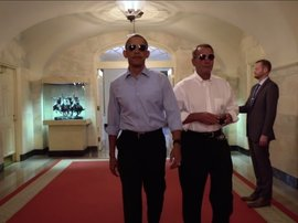Barack Obama and John Boehner walking with swagger in The White House