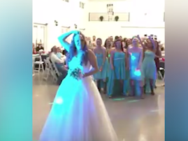 woman throws wig at wedding