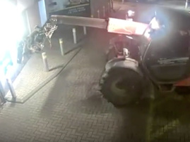 Thieves use digger to smash wall and steal ATM