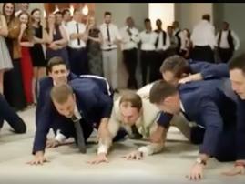 Groomsmen surprise bride with hilarious dance