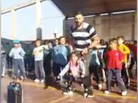 Teacher helps disabled girl join school dance