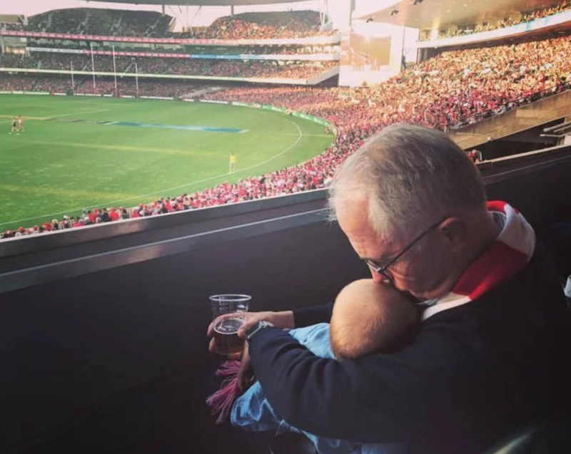 Is it acceptabe to drink beer while holding a baby?