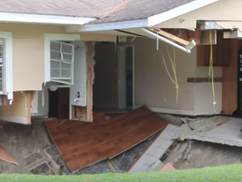 Family escapes just in time as sinkhole opens up and swallows their home