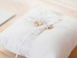 wedding rings on pillow pexels