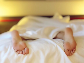 feet on bed pexels