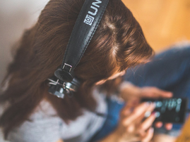 listening to music with headphones pexels
