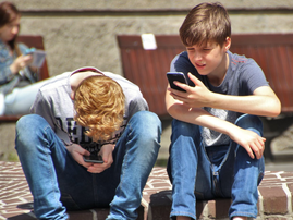 kids using cellphones pexel