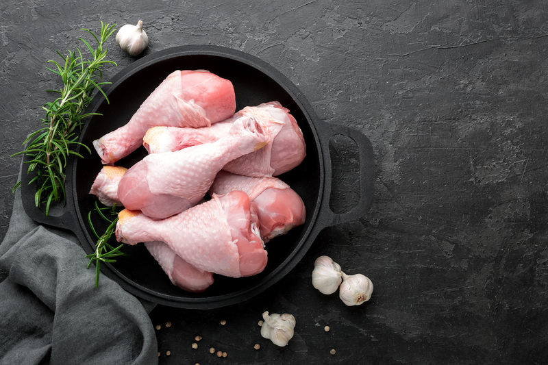 raw chicken drumsticks istock