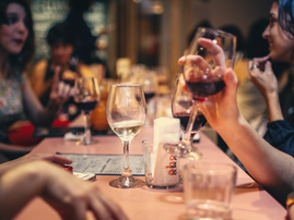 people drinking at table pexels