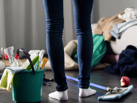 woman cleaning house istock