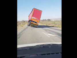 Truck tipped over by wind