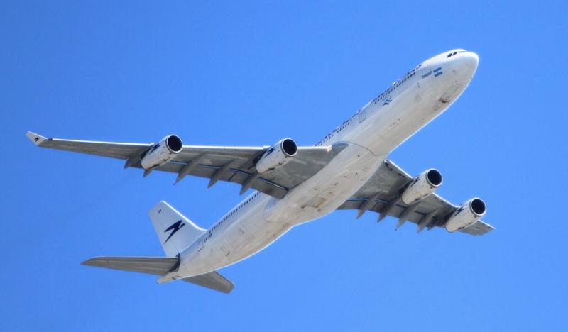 airplane in sky pexels