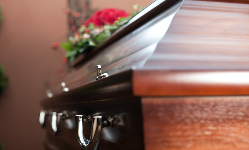 coffin at funeral istock