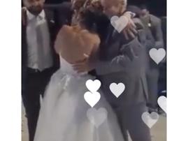 Groomsmen help groom with first dance