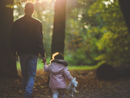 dad and daughter walking