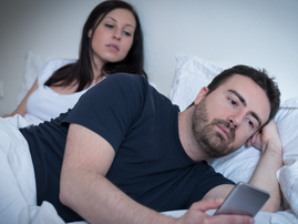 cellphone in bed / istock