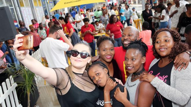 Holly Rey with fans at Umlazi Mega City / Instagram