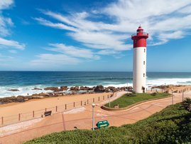 Lighthouse Against Blue Cloudy Coastal Seascape in Umhlanga / iStock