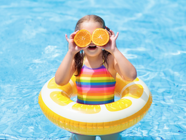 Little girl having fun in the pool / iStock