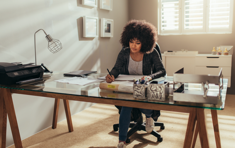 Woman working from home / iStock