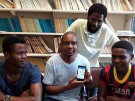 Lloyd Gordon shows UKZN statistics masters students Nqondeni Ndlangamandla (left), Dumisani Gwala (right) and Mkhize how his new maths app works