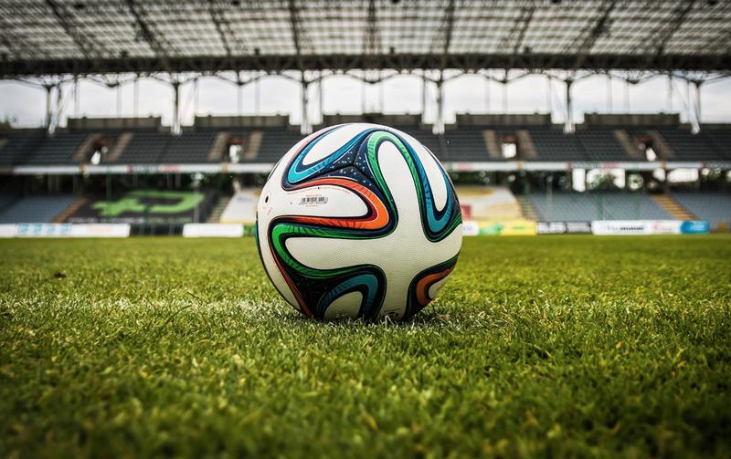 Soccer ball on field / Pexels
