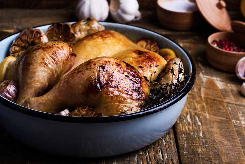 Roast chicken in a pan / iStock