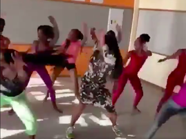 Naomi Campbell dances with school kids in South Africa