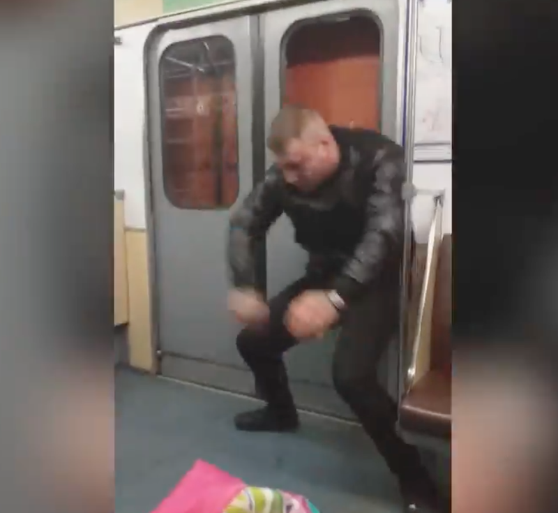 Man punches train doors