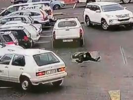 South African motorist run-down car guard in parking lot