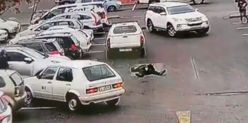 South African motorist run-down car guard in parking lot