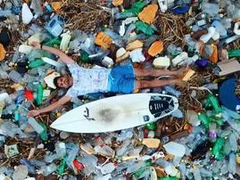 Rakesh Morar surrounded by plastic in the ocean / Facebook