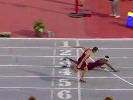 Athlete dive towards finishing line