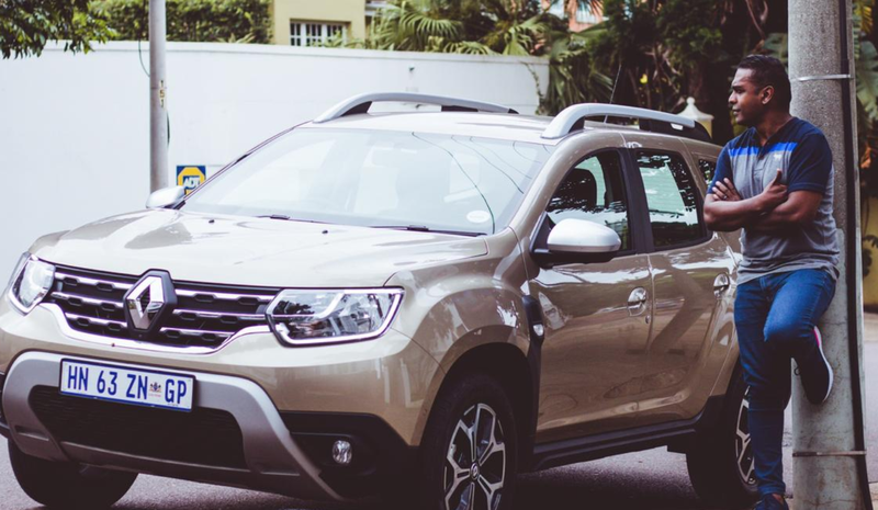 Deon Govender with the new Renault Duster / Supplied