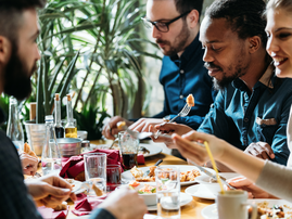 People eating at restaurant / iStock