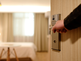 Person Holding on Door Lever Inside Room / Pexels